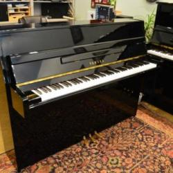 Yamaha M112 upright piano.