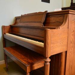 Yamaha Upright console style piano with wood finish